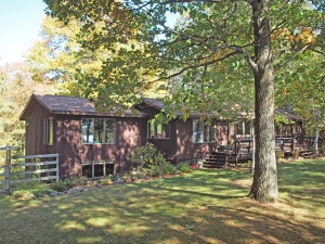 Spacious 4 BR home on 9.8 acres with 672' lake frontage